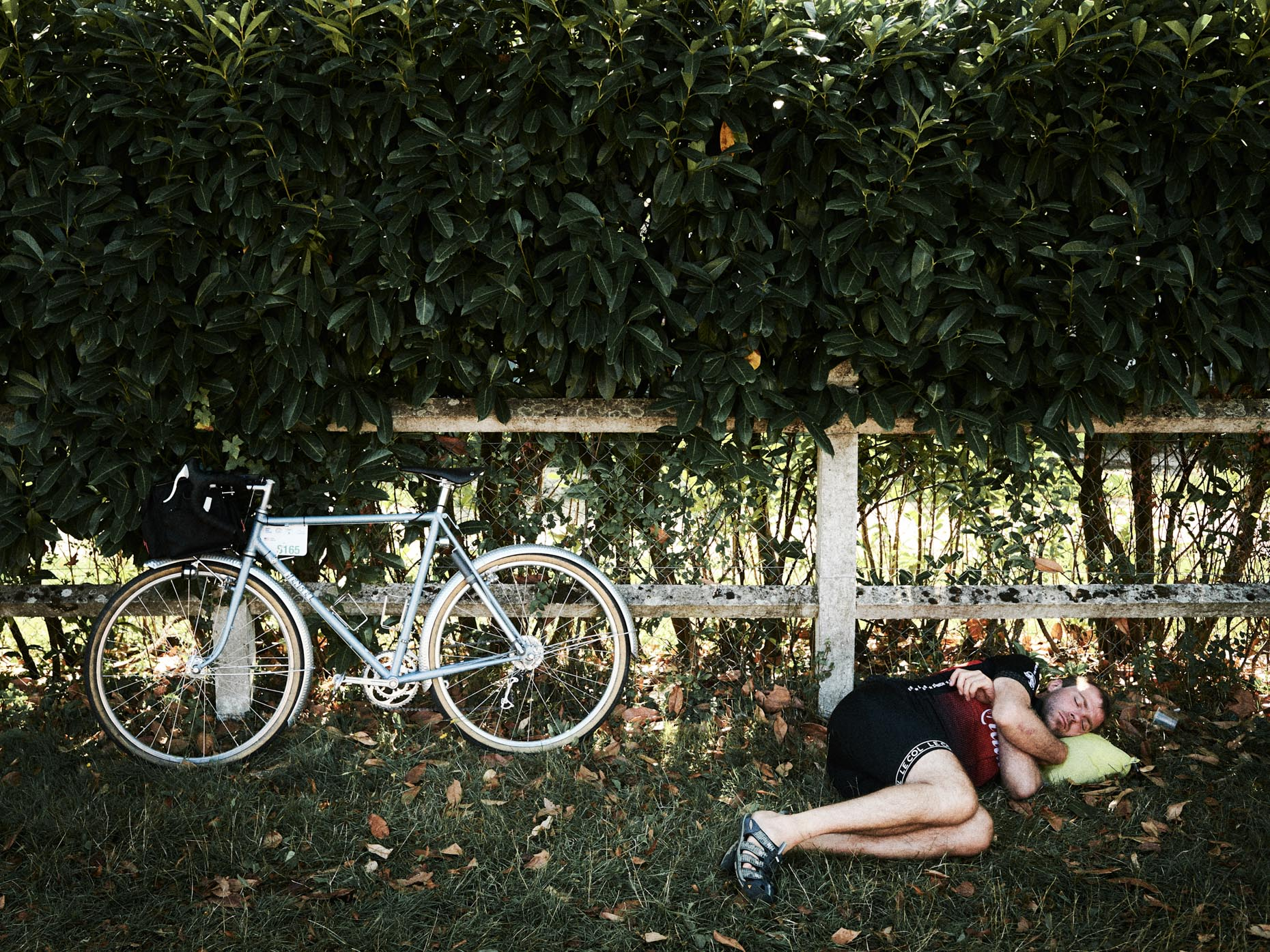 A sleeping biker after a race